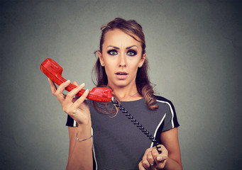 Confused woman with old phone