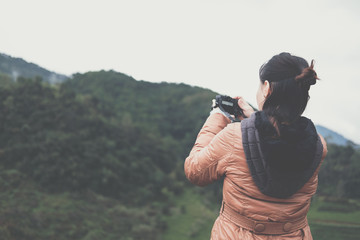 tourist use camera to take picture of mountain view. people, travel, nature concept.
