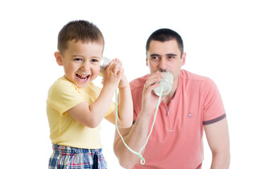Child boy and dad having a phone call with tin cans