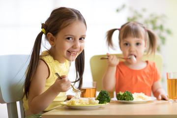 kids eating healthy food in nursery or at home
