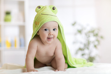 Cute seven months baby covered with green towel