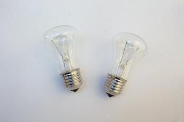 transparent light bulb lying on a white background