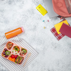 Open lunch box with sandwiches on office table with copy space
