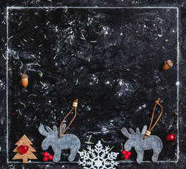 New year picture. Polish elk figurines on dark background