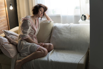 Young beautiful woman in a house dressing gown