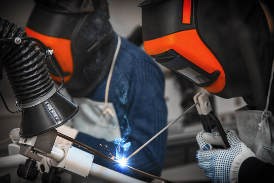 Welding and bright sparks.