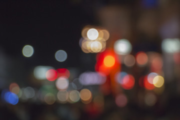 Night bokeh from light on the Road. Street light bokeh. Lights blurred bokeh background from christmas night party for your design.