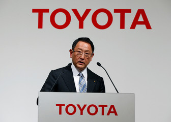 Toyota Motor Corp President  Toyoda attends a joint news conference with Panasonic Corp President Tsuga in Tokyo