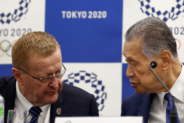 International Olympic Committee (IOC) Vice President John Coates (L) and President of Tokyo 2020 Olympic and Paralympic organising committee Yoshiro Mori attend a news conference in Tokyo
