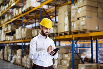 Warehouse worker or supervisor with barcode scanner.