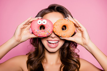 Diet, calories, healthcare, willpower, summer, body care, concept. Close up portrait of happy cute girl with sweet donuts like specs, laughing, so playful and hungry, sexy and hot