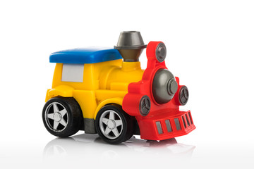 Colorful plastic toy train isolated on white background