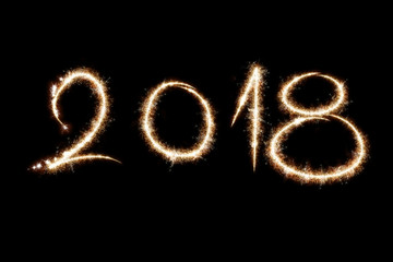2018 written with Sparkle firework on black background, happy new year 2018 concept
