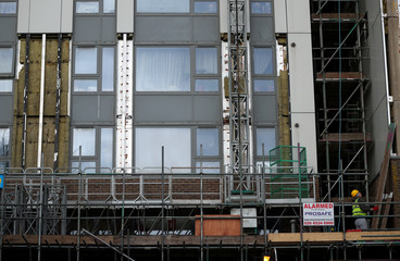 Workers remove cladding from Dorney Tower on the Chalcots estate in north London
