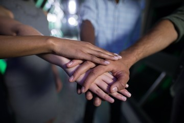 Close-up of business executives forming hand stack