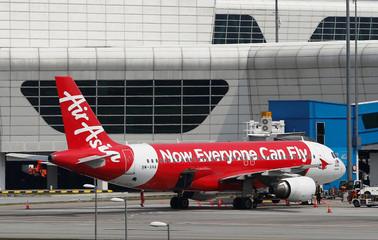 AirAsia plane is seen parked on the tarmac at Kuala Lumpur International Airport 2 (KLIA2) in Sepang