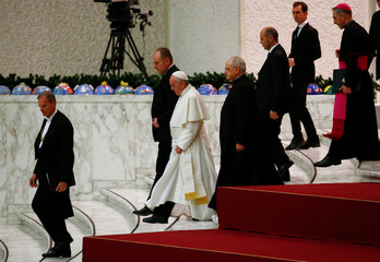 Pope Francis leaves at the end of his Wednesday general audience in Paul VI Audience Hall at the Vatican