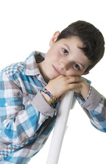 Portrait of a happy schoolboy isolated on a studio background