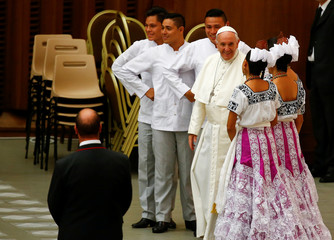 Pope Francis poses with South American dancers during his Wednesday general audience in Paul VI Audience Hall at the Vatican