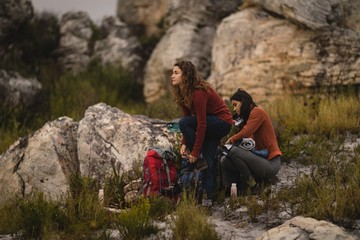 Female friends preparing for mountaineering