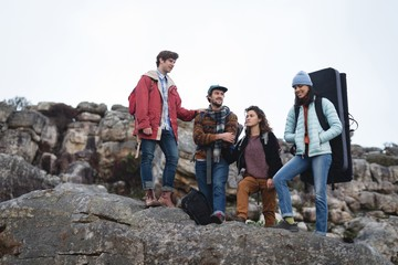 Friends standing on top of the cliff