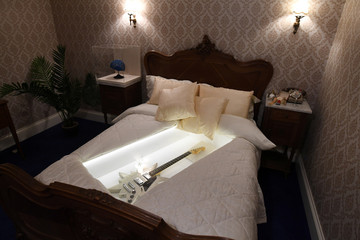 A bed is seen in a replica of the Napoleon Suite at the Brighton Grand Hotel where ABBA celebrated winning the 1974 Eurovision song contest as part of the  opening of 'ABBA: Super Troopers' exhibition at the Southbank Centre in London