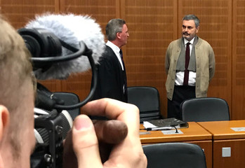 "Swedish John Ausonius, dubbed the ""laser man"", waits for the start of his trial in Frankfurt"
