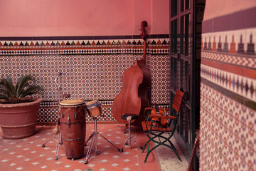 Aluminium Prints Havana Musical Instruments in the background of a decorative wall, streets of Havana, Cuba