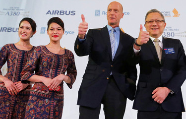 Airbus Chief Executive Tom Enders and Executive Vice President of Commercial at Singapore Airlines Mak Swee Wah attend a ceremony during the delivery of the new Airbus A380 aircraft to Singapore Airlines in Colomiers