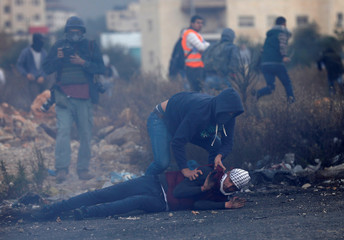 Undercover Israeli security personnel detains a Palestinian demonstrator during clashes at a protest near the Jewish settlement of Beit El, near the West Bank city of Ramallah