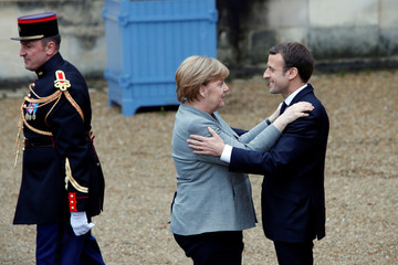 German Chancellor Angela Merkel arrives at a gathering of leaders of the G5 Sahel countries, Germany, Italy and Saudi Arabia gather in La Celle Saint Cloud