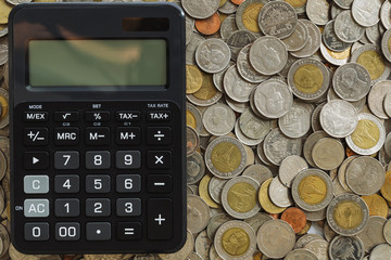 Business finance concept calculator on coins background
