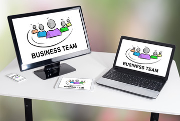 Business team concept on different devices