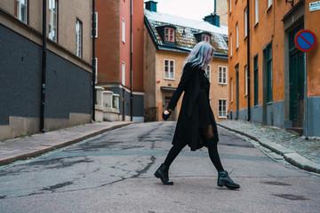 Vogue woman in black coat