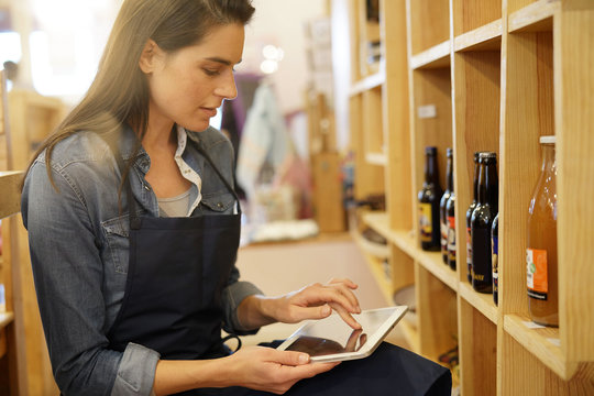 Shop tender checking products availibility on shelves