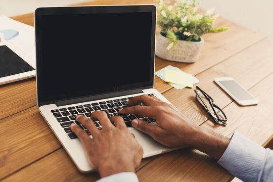 African-american businessman typing on laptop