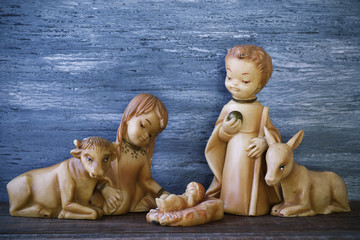 the holy family in a rustic nativity scene
