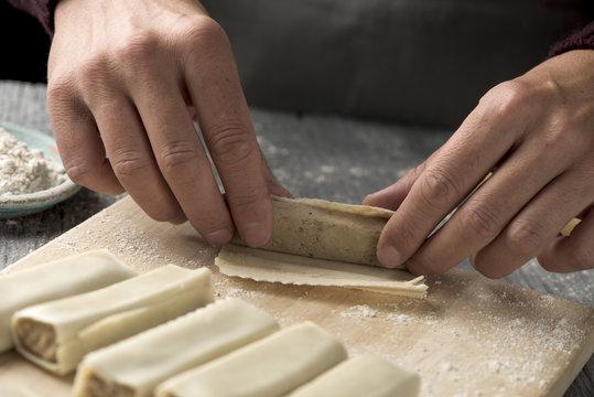 man preparing meat stuffed cannelloni