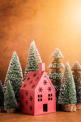 christmas and newyear concept with arrange of decorating items house and treewith free copy space for your creativity ideas text