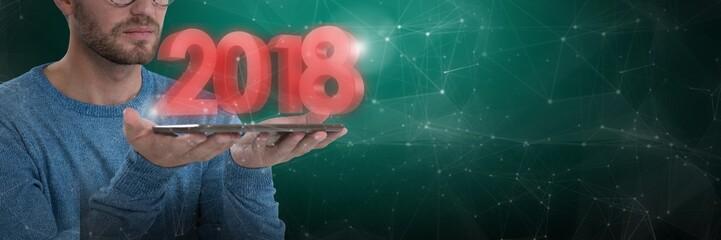 Composite image of man holding digital tablet