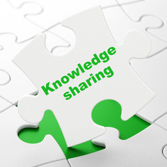 Learning concept: Knowledge Sharing on White puzzle pieces background, 3D rendering
