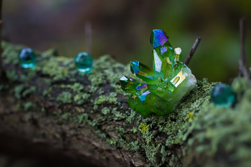Green magical crystals in the forest