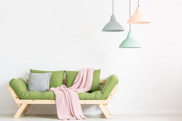 Green sofa in white room