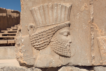 Ruined portrait of persian man with beard. Relief on wall of abandoned city Persepolis, capital of Achaemenid Empire, 550 - 330 BC