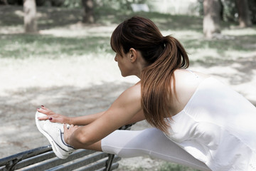 Woman stretching on a bench