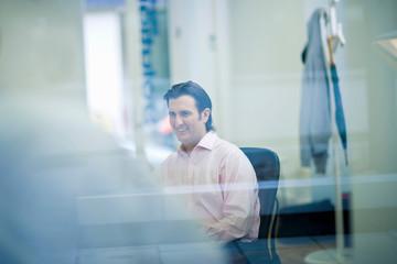 Portrait of businessman through window
