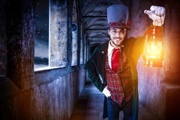 Foto op Aluminium Imagination man with lamp and dark night