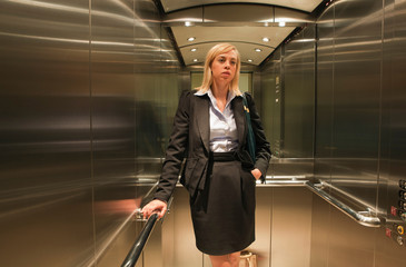 Woman standing in lift