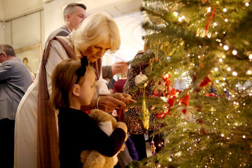 Britain's Camilla, Duchess of Cornwall is seen with children from Helen & Douglas House and Roald Dhal's Marvellous Children's Charity decorating the Clarence House Christmas tree at Clarence House  in London