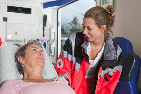 Ambulance woman caring about woman